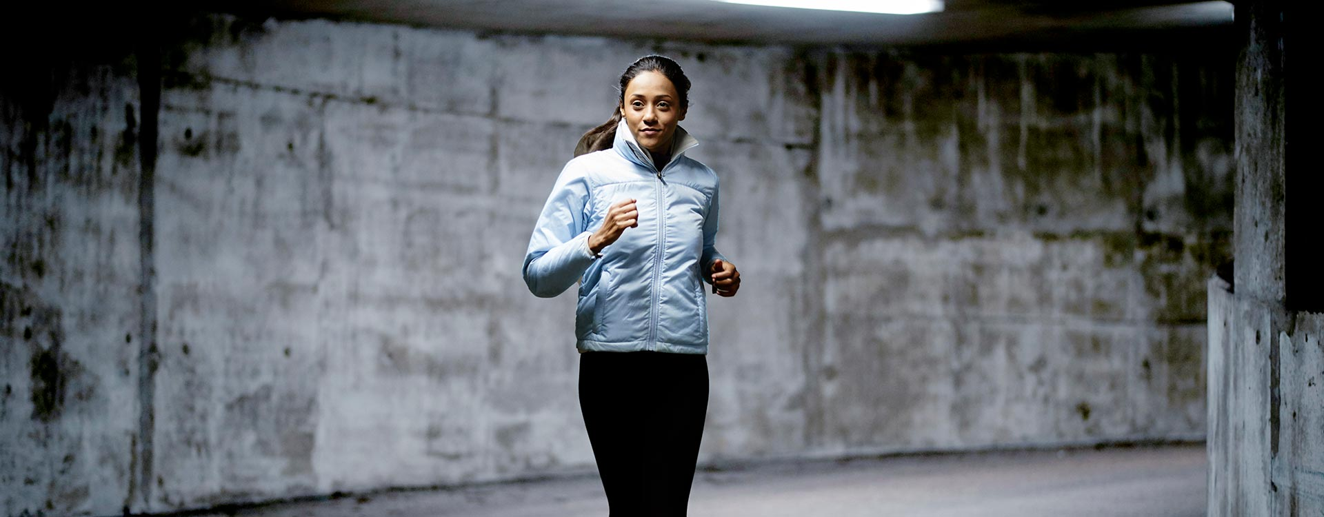 Female Professional Running in Tunnel