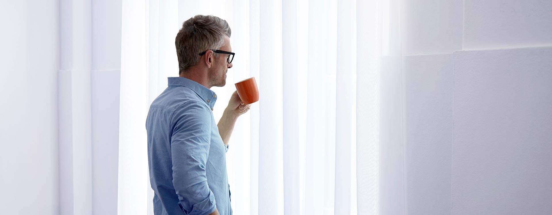 Male Professional Thinking while Drinking Coffee