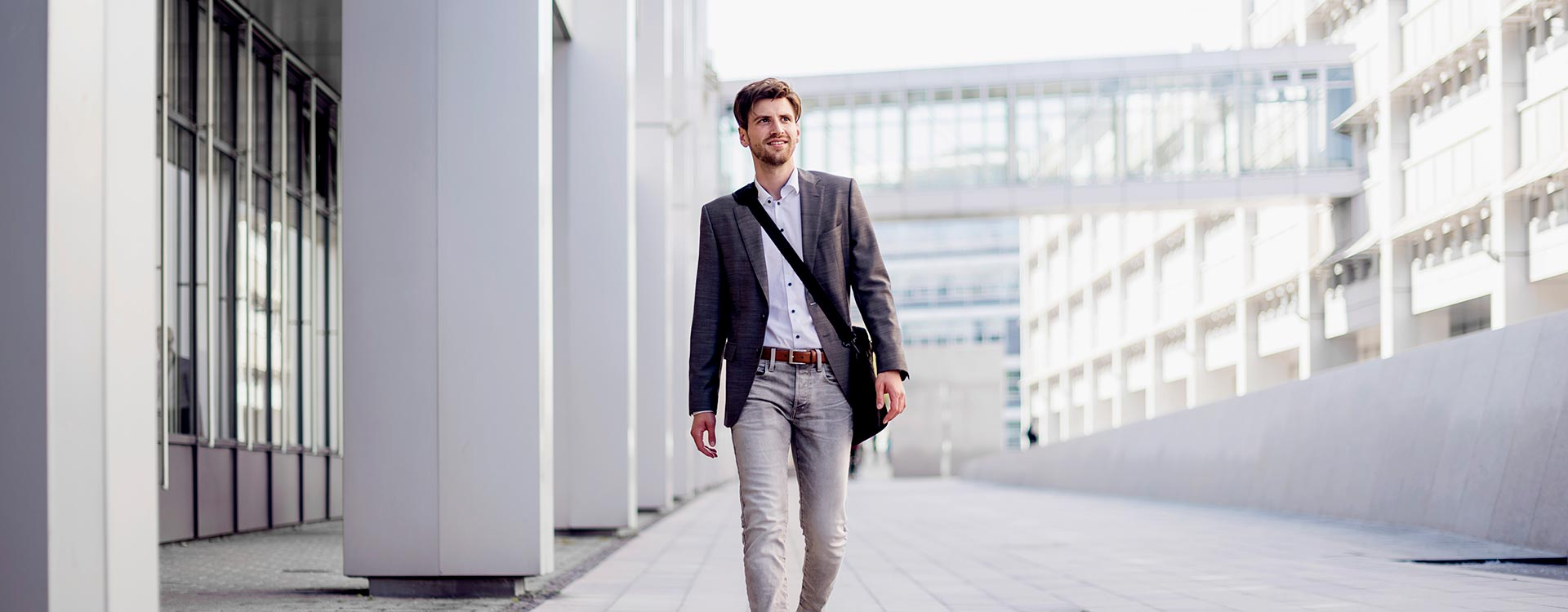 Male Professional Walking into Office Building