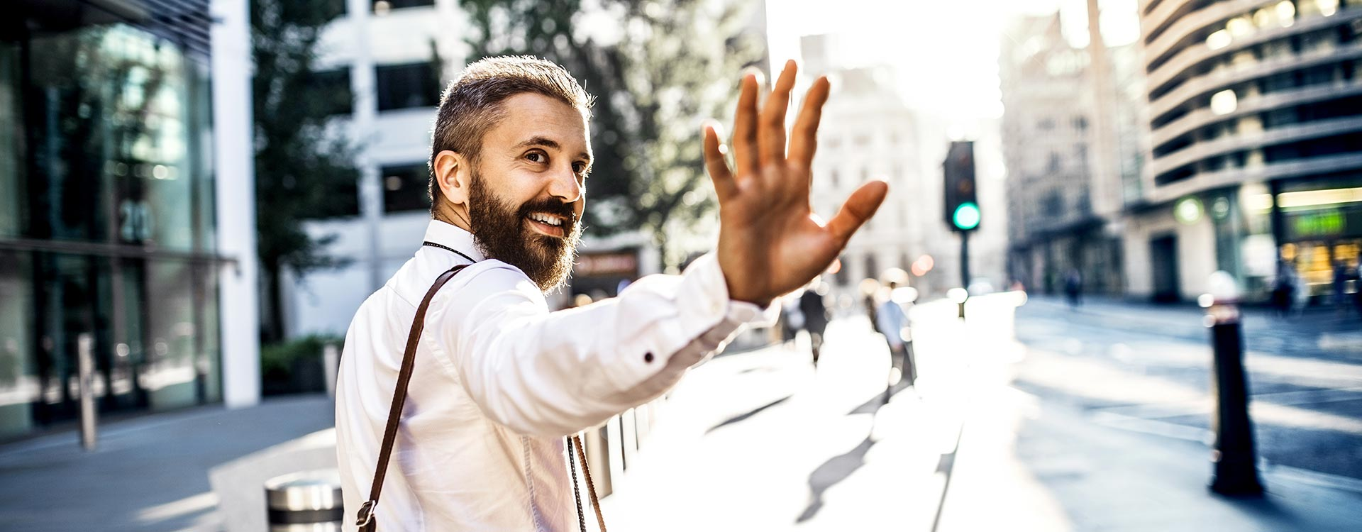 Male Professional Waving Near City Street