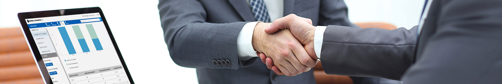 Two executives shaking hands