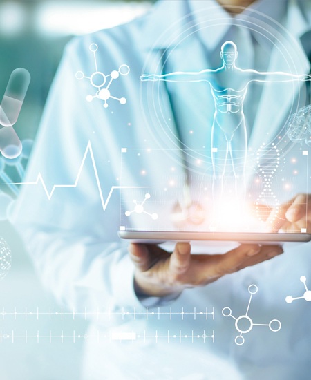 Doctor holding tablet with digital human form and medical graphs rising out of it