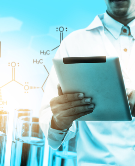 Scientist working on a tablet with chemical chains and beakers in the background