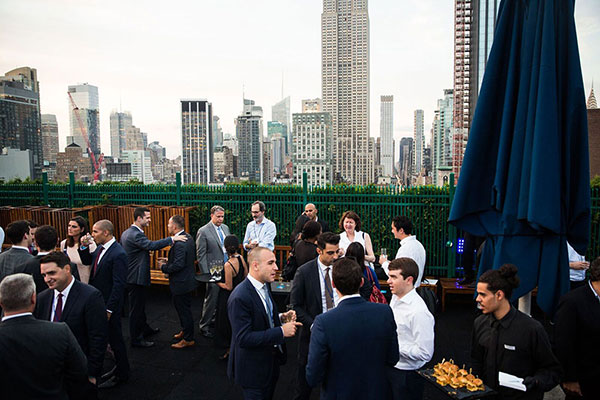 NYC DatasiteOne Rooftop Crowd and skyline