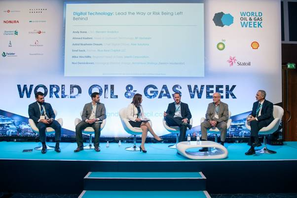 Panel of speakers sitting and talking at World Oil & Gas Week